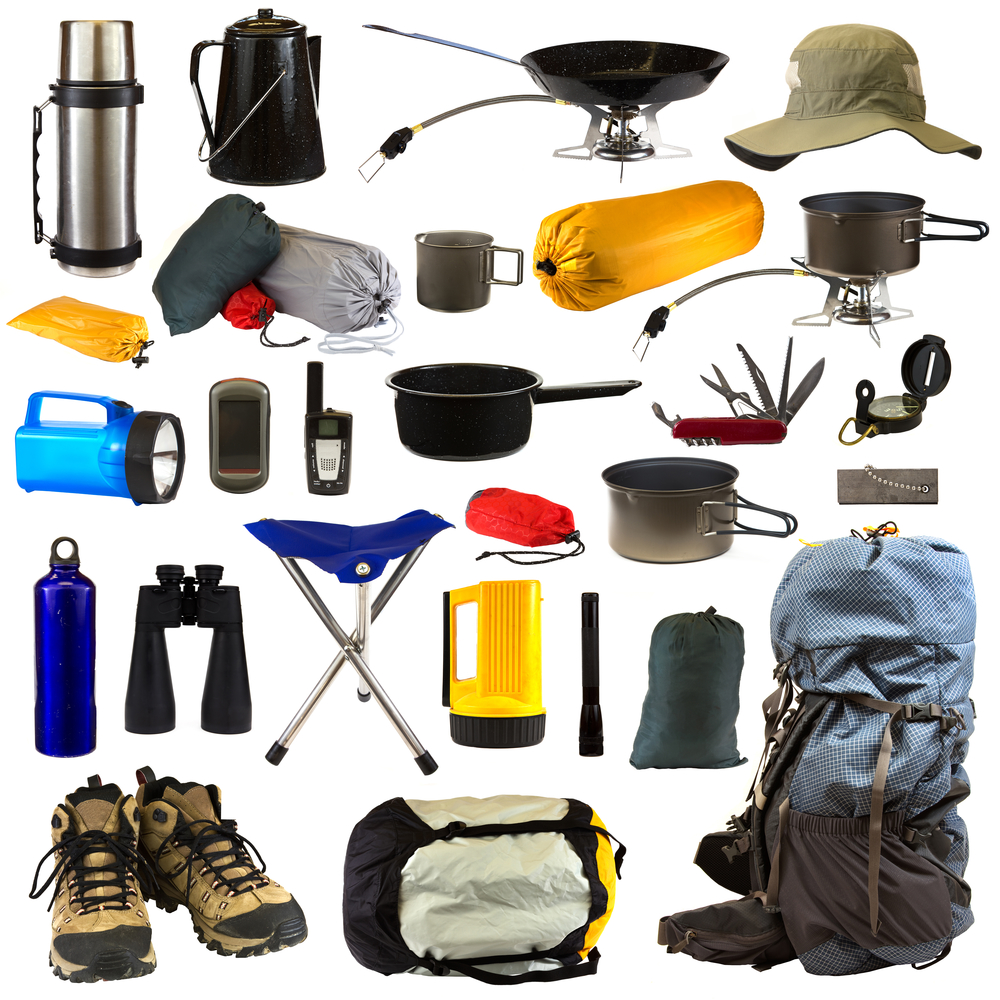 Camping gear collage isolated on white background depicting a thermos, coffee pot, frying pan sitting on stove, hat, bags of camping equipment, stainless steel mug, pot sitting on stove, blue flashlight, GPS, walkie talkie, pot, Swiss army knife, compass, blue water bottle, black binoculars, chair, yellow flashlight, black flashlight, magnesium fire starter, backpack, hiking boots and sleeping bag.