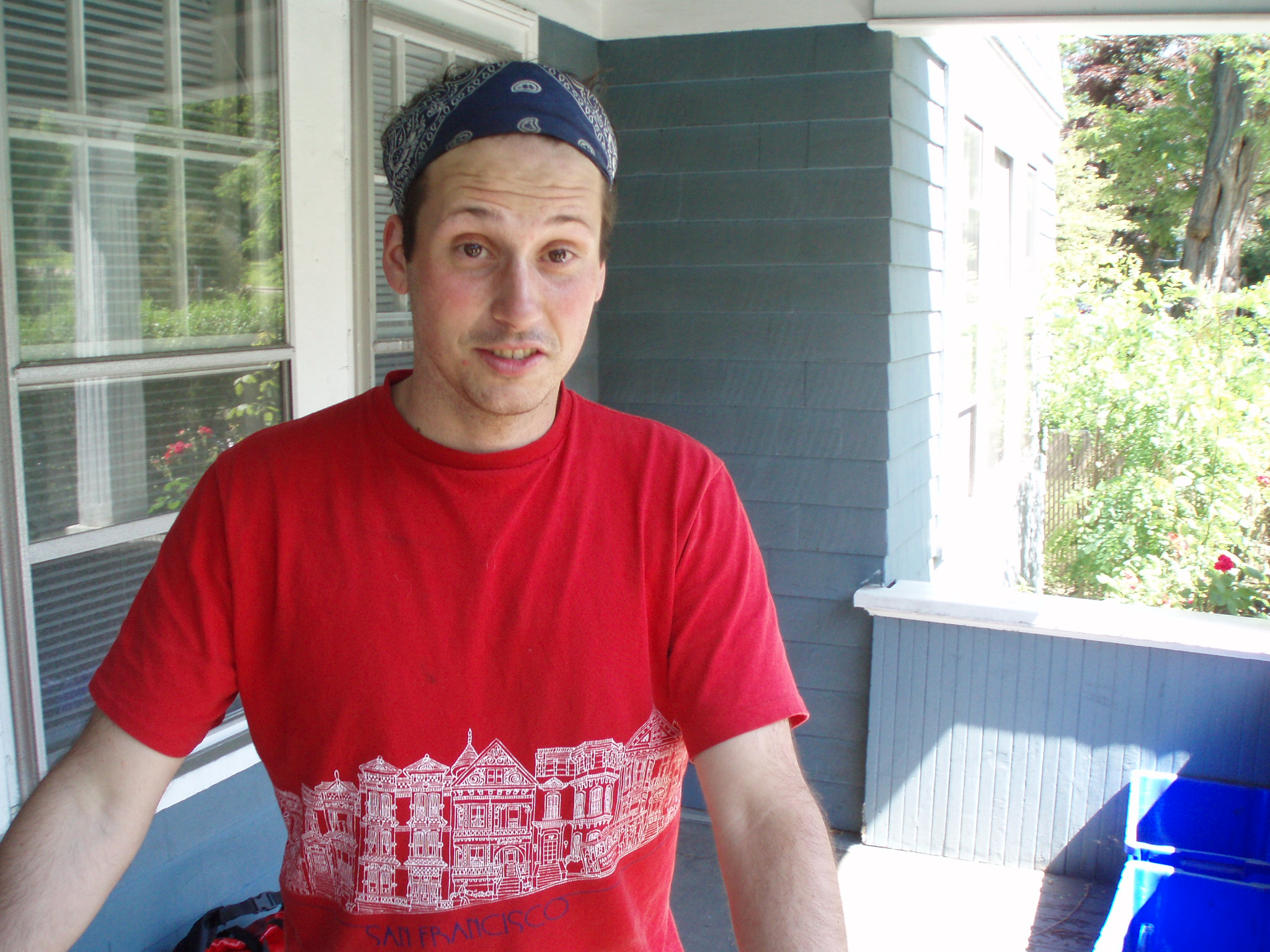 Mike Riscica wearing a red shirt and a bandanna