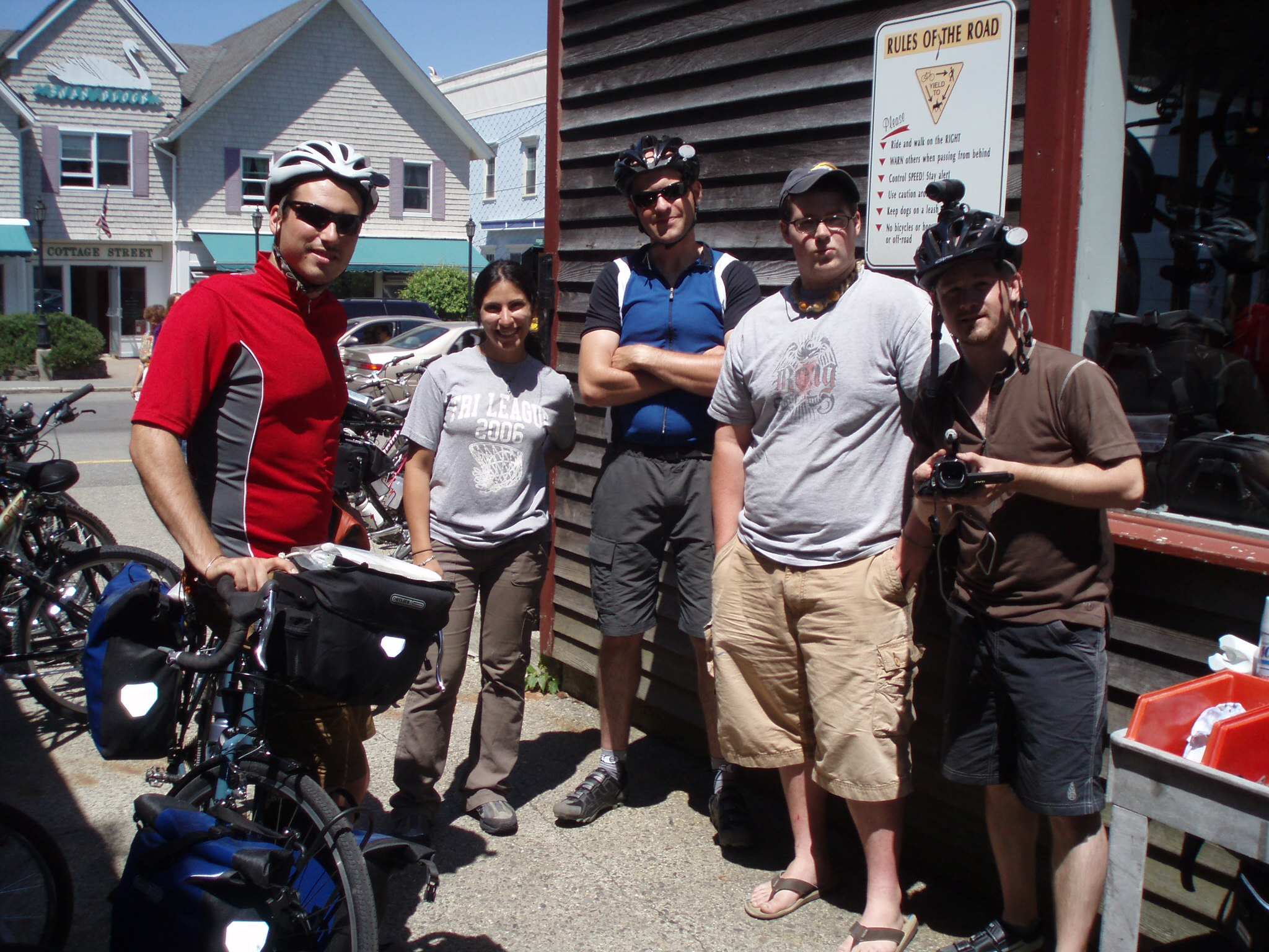 Group Photo of Mike, Chuck and Jamie meeting other people at a bike shop