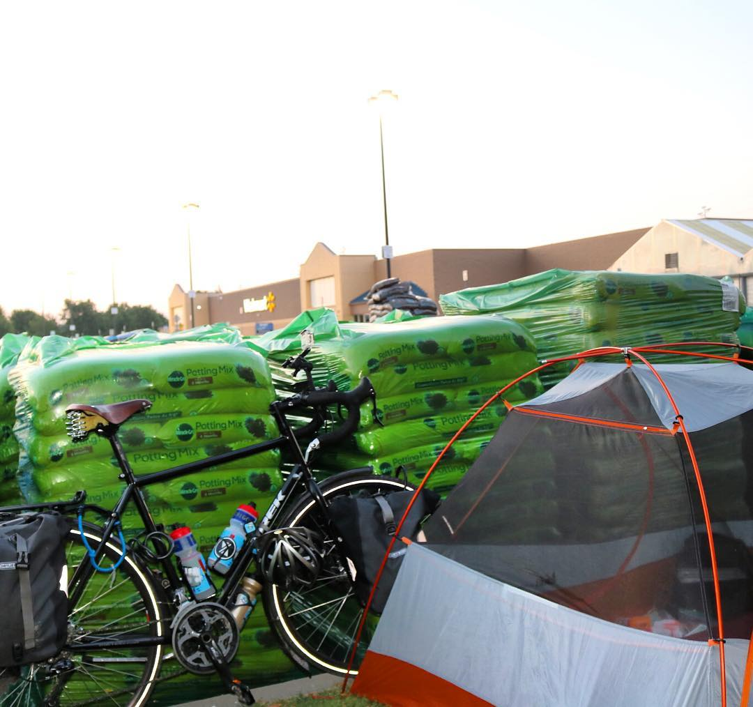 Camped out last night behind the pallets of organic potting mix in the Walmart parking lot after an 80 mile day. The Walmart wifi works out here. This bike tour gets a little more glamorous every single day. #transam2016 #biketouring #biketour #bikepacking #biketouringlikeaboss #getmeoutofthistown #walmart #walmartparkinglot #mayorofwalmartcity