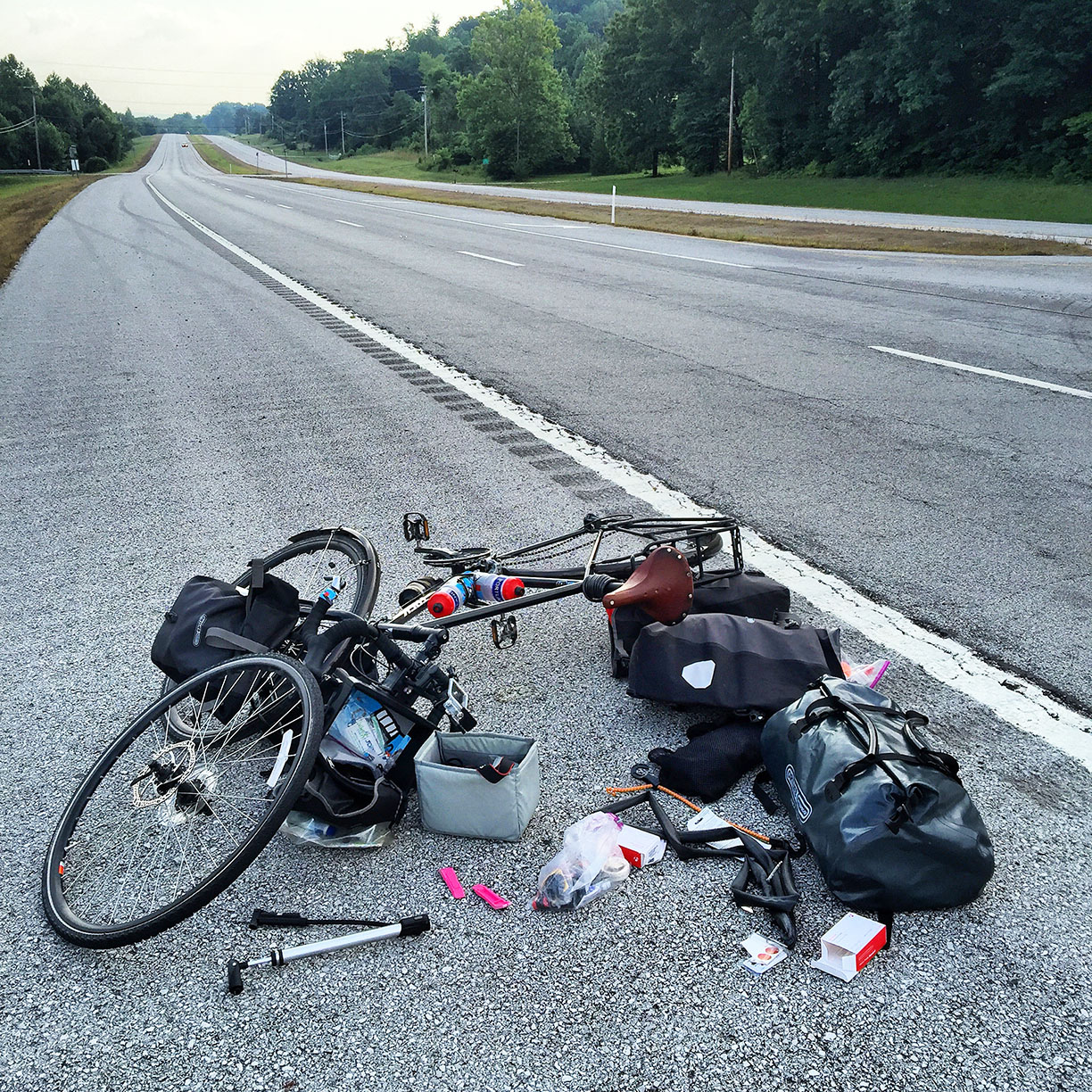 First flat tire today at mile 760! I didn't realize it, but I was also headed 7 miles down the road in the wrong direction. If I didn't get this flat tire I would have just kept going. #transam2016 #readthemap #dumbass #biketouring #flattire